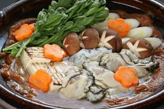 Kaki dotenabe , oyster cooked in a pot at the tabl. E , japanese food Stock Image