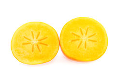 Kaki fruit cut in half Stock Photos