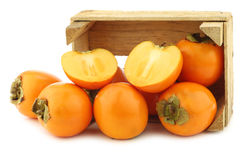 kaki fruit in a wooden box Stock Images