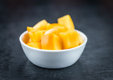 Kaki fruits on a slate slab selective focus Royalty Free Stock Photography