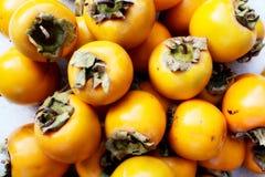 Kakipflaumenbaum nicht schon reif lizenzfreie stockbilder