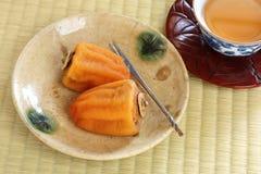 Kakis secs japonais, bonbons japonais photographie stock libre de droits
