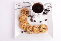 Kakor och choklad med te fotografering för bildbyråer