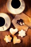 Kakor och kaffe Royaltyfri Foto