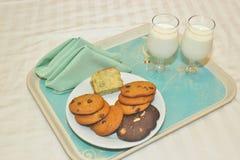 Kakor och mjölkar Arkivfoton