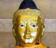 Kakusandha buddha image covered with foilgold Royalty Free Stock Photos