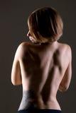 Kal ung kvinna tillbaka arkivfoton