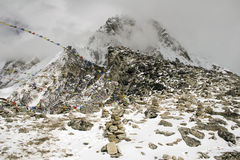 Kala Patthar - Nepal. Looking up towards the summit of Kala Patthar. This summit provides the best views of Everest. Several hikers can be seen on the summit Stock Photos