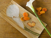 Kala plate with dry apricots Stock Photos