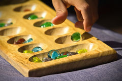 Kalaha Board Game. Photograph taken during a kalaha board game Royalty Free Stock Photo
