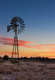 Kalahati sunset with trees grass windmill and blue sky Royalty Free Stock Photo
