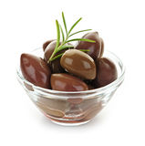 Kalamata olives. In olive oil and herbs in bowl stock photography