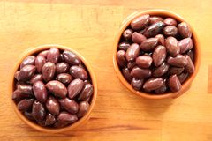 Kalamata Olives. In bowls on a wooden board stock images