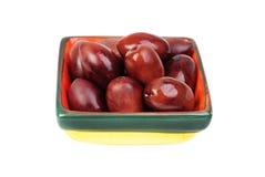 Kalamata olives in bowl Stock Photography