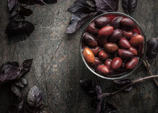 Kalamata olives in   brine on the glass dish  with red basil Royalty Free Stock Photo