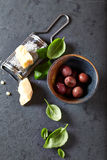 Kalamata olives, parmesan and fresh basil leaves royalty free stock images