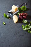 Kalamata olives, parmesan and fresh basil leaves stock image