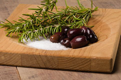 Kalamata olives and rosemary being prepared Stock Photography