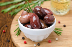 Kalamata olives and spices on a wooden board Royalty Free Stock Photos