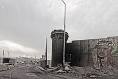 Kalandia Checkpoint in Ramallah. With grafitti of Yasser Arafat royalty free stock images