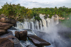 Kalandula waterfalls of Angola in full flow. With lush green rain forest, rocks and spray Royalty Free Stock Images