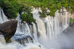 Kalandula waterfalls of Angola in full flow. With lush green rain forest, rocks and spray Royalty Free Stock Image