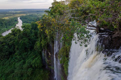 Kalandula waterfalls of Angola with river in background. Kalandula waterfalls of Angola in full flow with lush green rain forest and the river in the distance Royalty Free Stock Photography