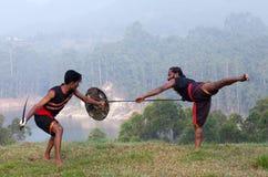 Kalaripayattu marital art demonstration in Kerala, South India. Indian fighters performing weapon combat with lance, sword and shield during Kalaripayattu Stock Image