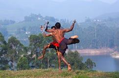 Kalaripayattu marital art demonstration in Kerala, South India. Indian fighters performing weapon combat with sword and shield during Kalaripayattu marital art Stock Photo