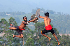 Kalaripayattu Martial Art in Kerala, India. Indian fighters performing Aayudha Payattu Weapon Combat during Kalaripayattu Marital art demonstration in Kerala stock photos