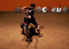 Kalaripayattu Martial Art in Kerala, South India. MUNNAR, KERALA, INDIA - JANUARY 18, 2016: Two Indian men performing Kalaripayattu marital art in Kerala, India Stock Photo
