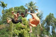 Kalarippayat, indian ancient martial art of Kerala. Kalarippayat,fight in air, indian ancient martial art of Kerala royalty free stock images