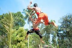 Kalarippayat, Kampf in einer Luft, alte Kampfkunst Stockfotos