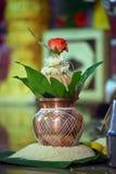 Kalasha with Rose flower. Holy Kalasha with Rose and rice royalty free stock images
