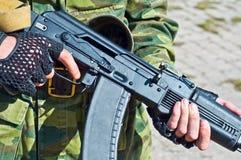 Kalashnikov AK-101 machine gun. Kalashnikov AK-105 machine gun in the hands Stock Photos