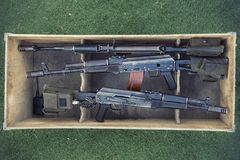 Kalashnikov assault rifles in wooden box. Arms trade. illegal sale of weapons. An automatic weapon with a sniper scope. Kalashnikov assault rifles in a wooden Stock Photos