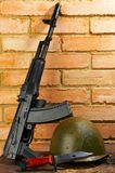 Kalashnikov automatic. Military helmet the automatic device and a knife Royalty Free Stock Images