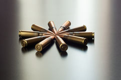 Kalashnikov bullets on the table. Royalty Free Stock Photos