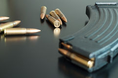 Kalashnikov bullets on the table. Royalty Free Stock Photography