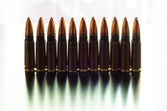 Kalashnikov bullets in two raws. Stock Photos