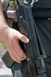 Kalashnikov machine gun in the hands of Ukrainian policeman. Stock Image