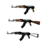 Kalashnikov submachine guns. Three Kalashnikov submachine guns isolated on white background Royalty Free Stock Photo