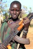 Kalashnikovpojke Fotografering för Bildbyråer