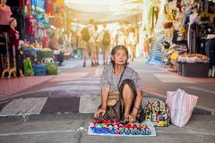 Adult, Cap, People, Senior Adult, Senior Women. Kalasin,Thailand,february,27,2018,Old woman sitting on the floor of the street to sell souvenirs at, Kalasin Royalty Free Stock Image