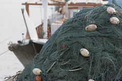 Kalba UAE Fishing nets piled high on boat in Kalbar Fujairah Stock Photos