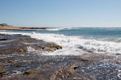 Kalbarri Coast Line. Jake's Point beach with sandstone rocky outcropping, fringe reef and turquoise Indian Ocean waters under clear blue skies in Kalbarri Royalty Free Stock Photo
