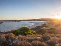 Sunrise over the Murchison River mouth and Kalbarri town. Kalbarri is a popular tourist destination, six hours drive north of Perth, Western Australia Stock Photo