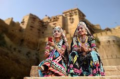 Kalbelia dancers in traditional attire outside Jaisalmer fort. Rajasthan, India - February 10, 2018: Beautiful Kalbelia dancers in traditional black Rajasthani Stock Photo