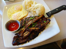 Kalbi steak ribs with two eggs over easy, two scoops of rice and Royalty Free Stock Image