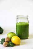 Kale apple lemon ginger juice vertical Royalty Free Stock Images